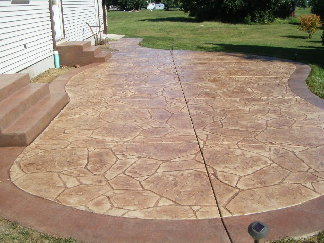 Red Arizona stone stamped concrete stone texture steps.