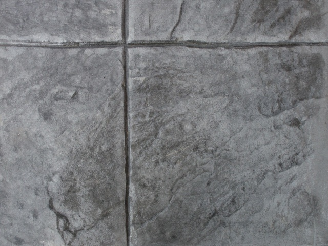 Closeup photo of a 16x16 slate concrete stamp.