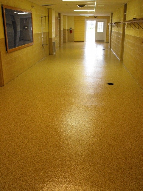 A hallway with a smooth, refinished polyaspartic-coated floor coating