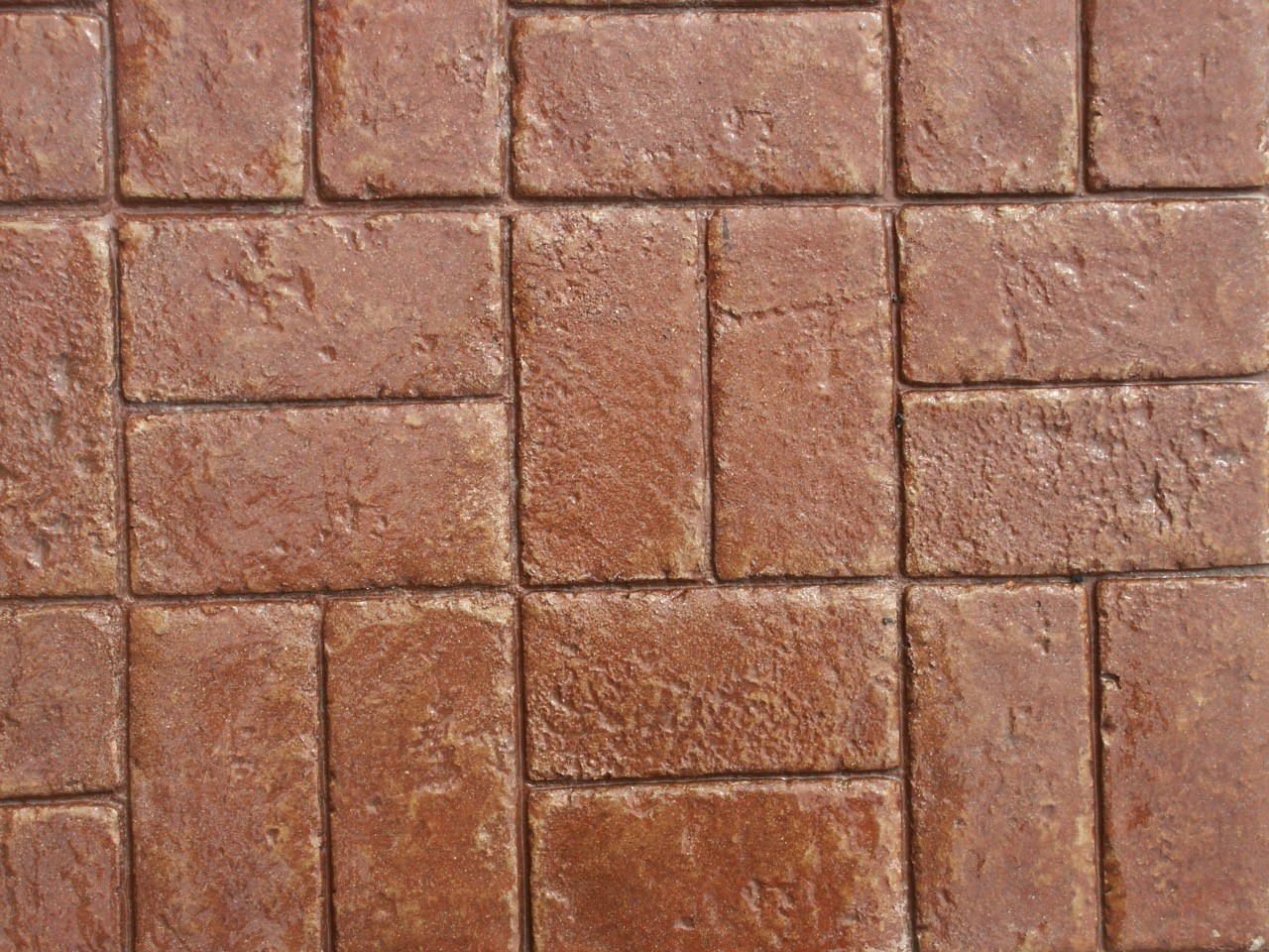 Closeup photo of a Basketweave brick concrete stamp.