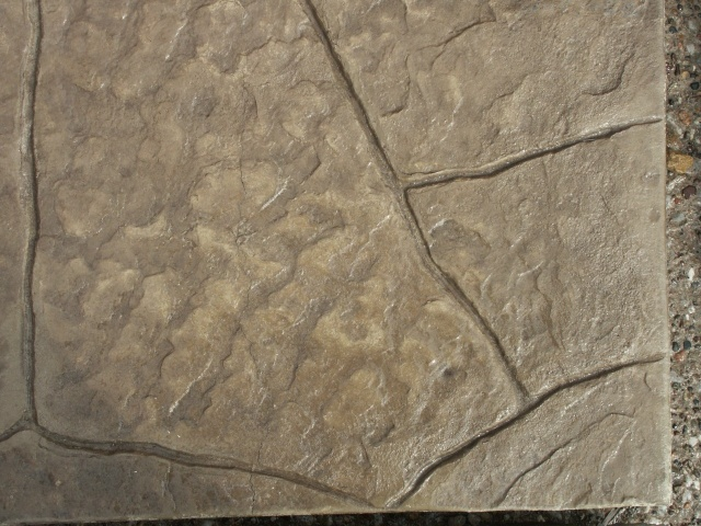 Closeup photo of a Castle stone concrete stamp.