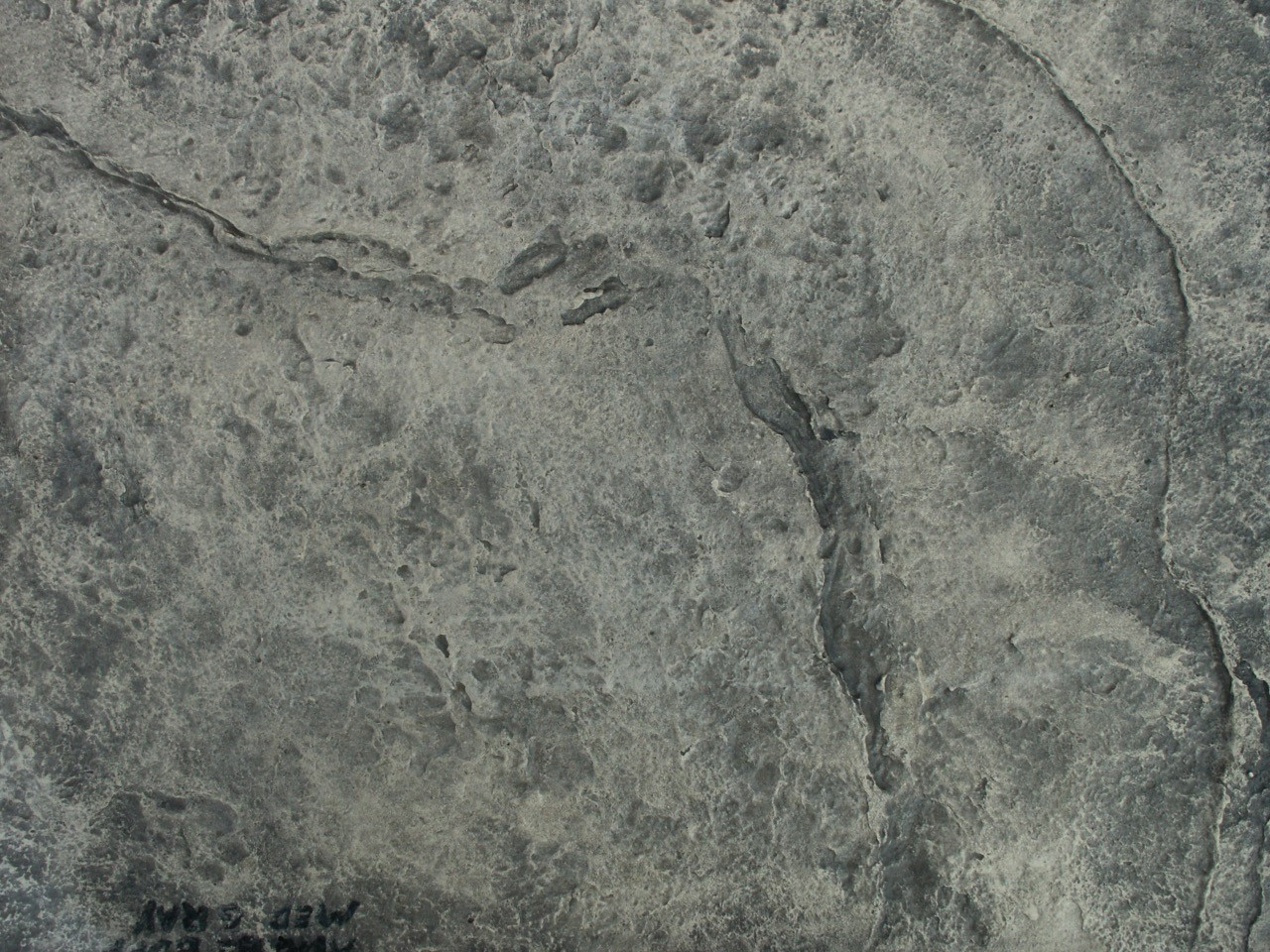 Closeup photo of a Heavy stone texture concrete stamp.