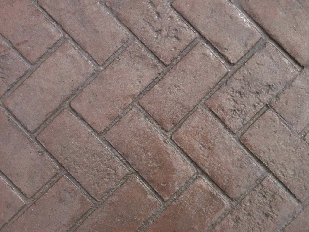 Closeup photo of a Herringbone brick concrete stamp.