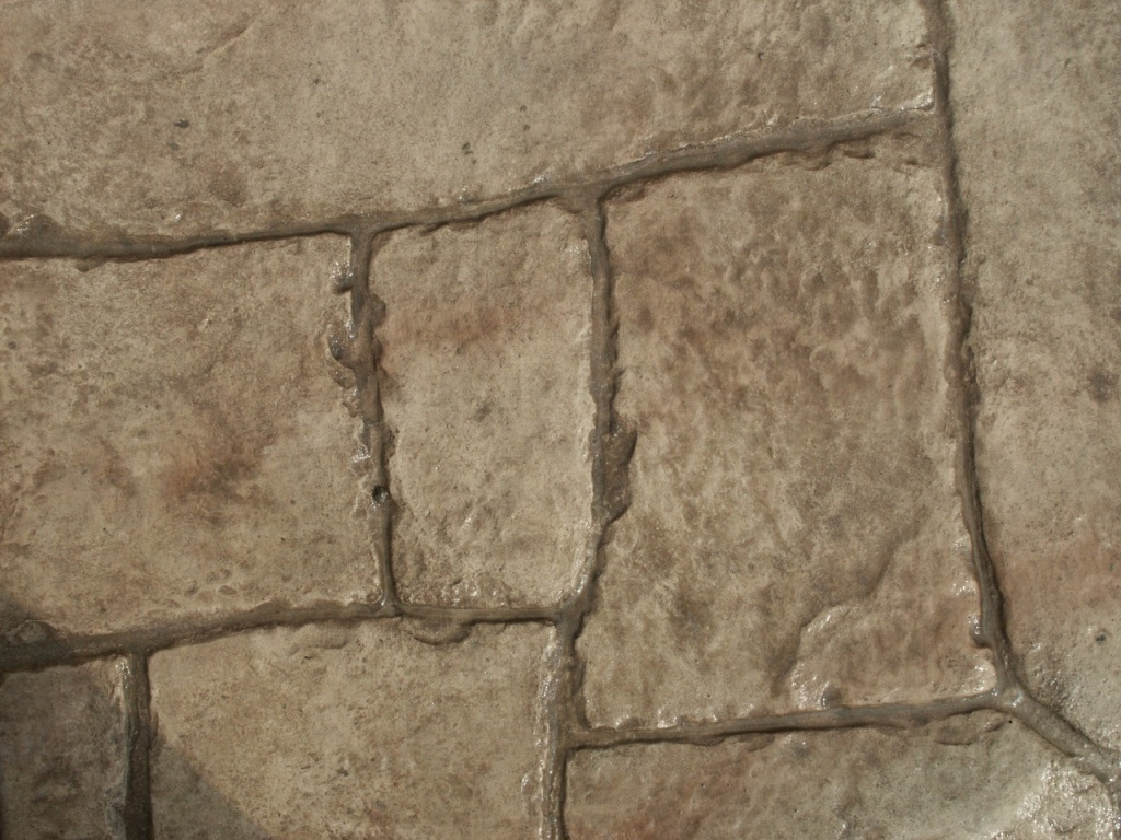 Closeup photo of a large Appian cobble concrete stamp.