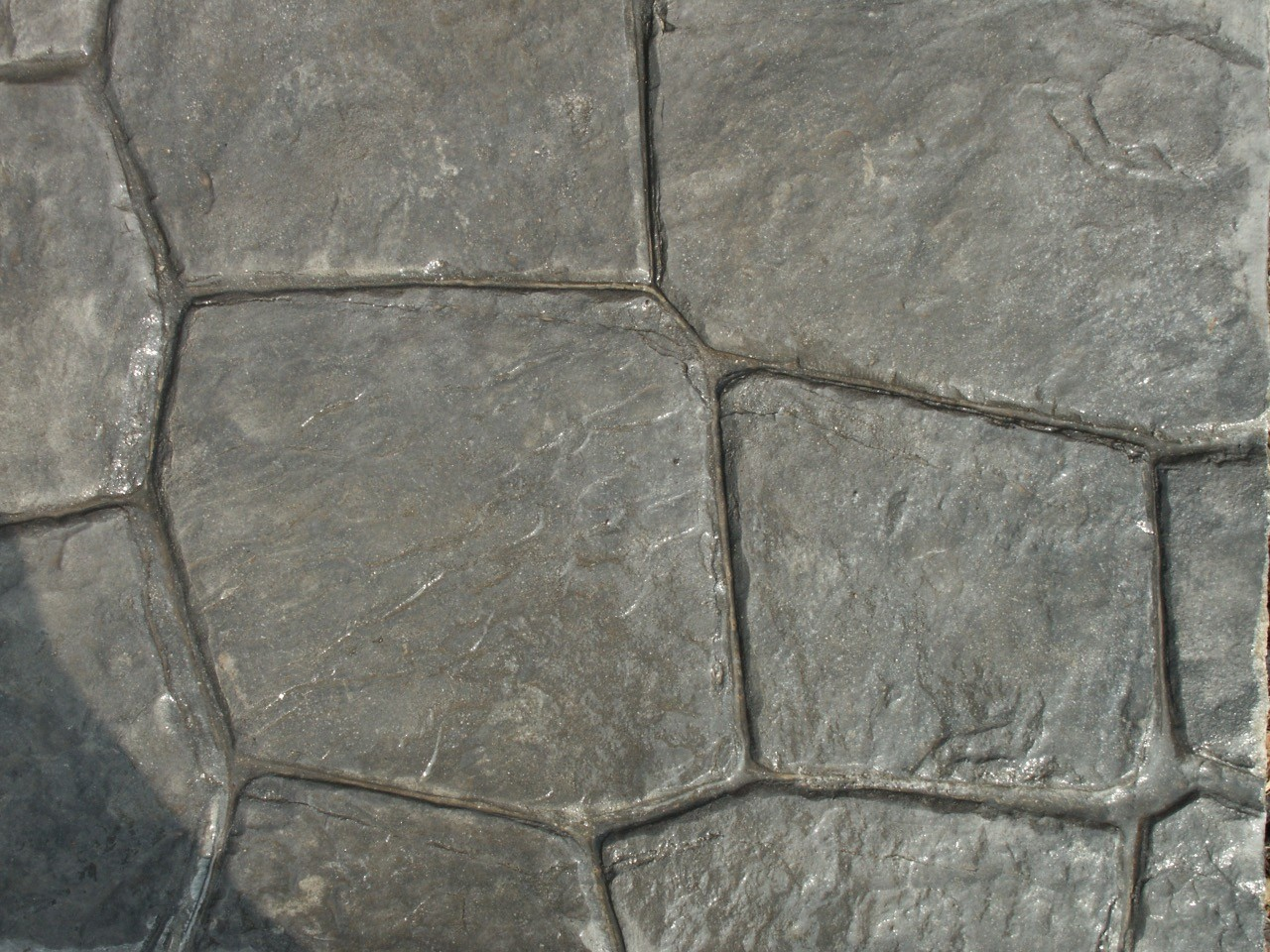Closeup photo of a Luccia Stone concrete stamp.