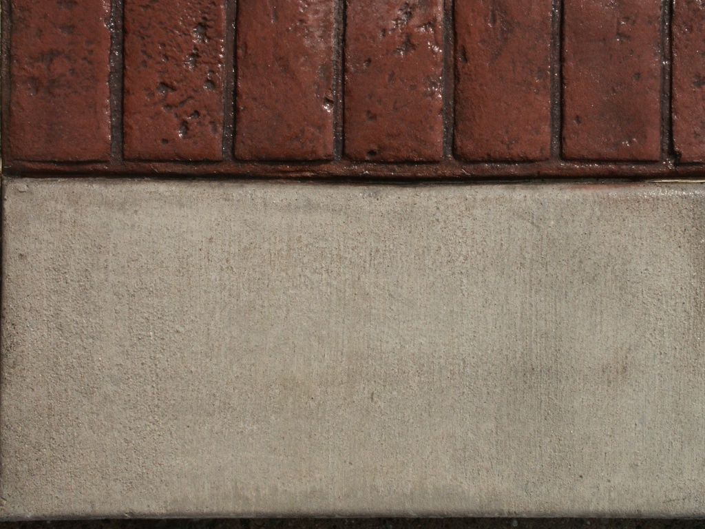 Closeup photo of a soldier course concrete stamp.