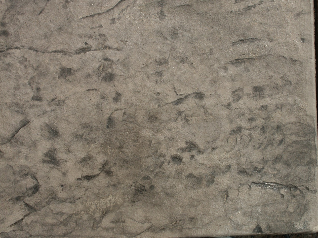 Closeup photo of a stone texture concrete stamp.