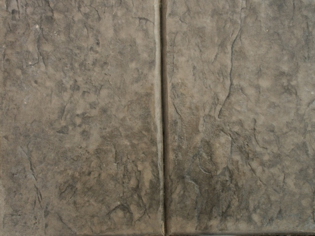Closeup photo of a stone texture with tooled joint concrete stamp.