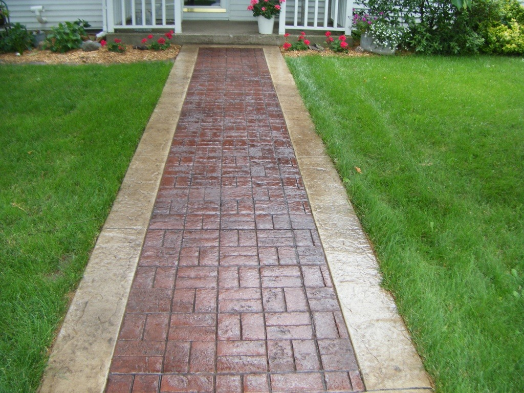 Basketweave brick stone texture with borders, leading up to a home.