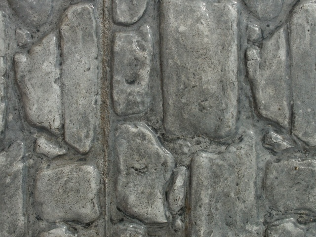 Closeup photo of a cobblestone concrete stamp.
