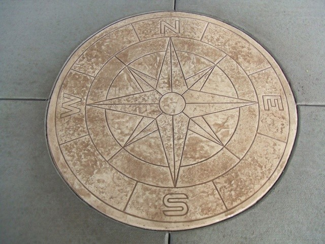 Compass rose stamp in the Davenport riverside pavilion.