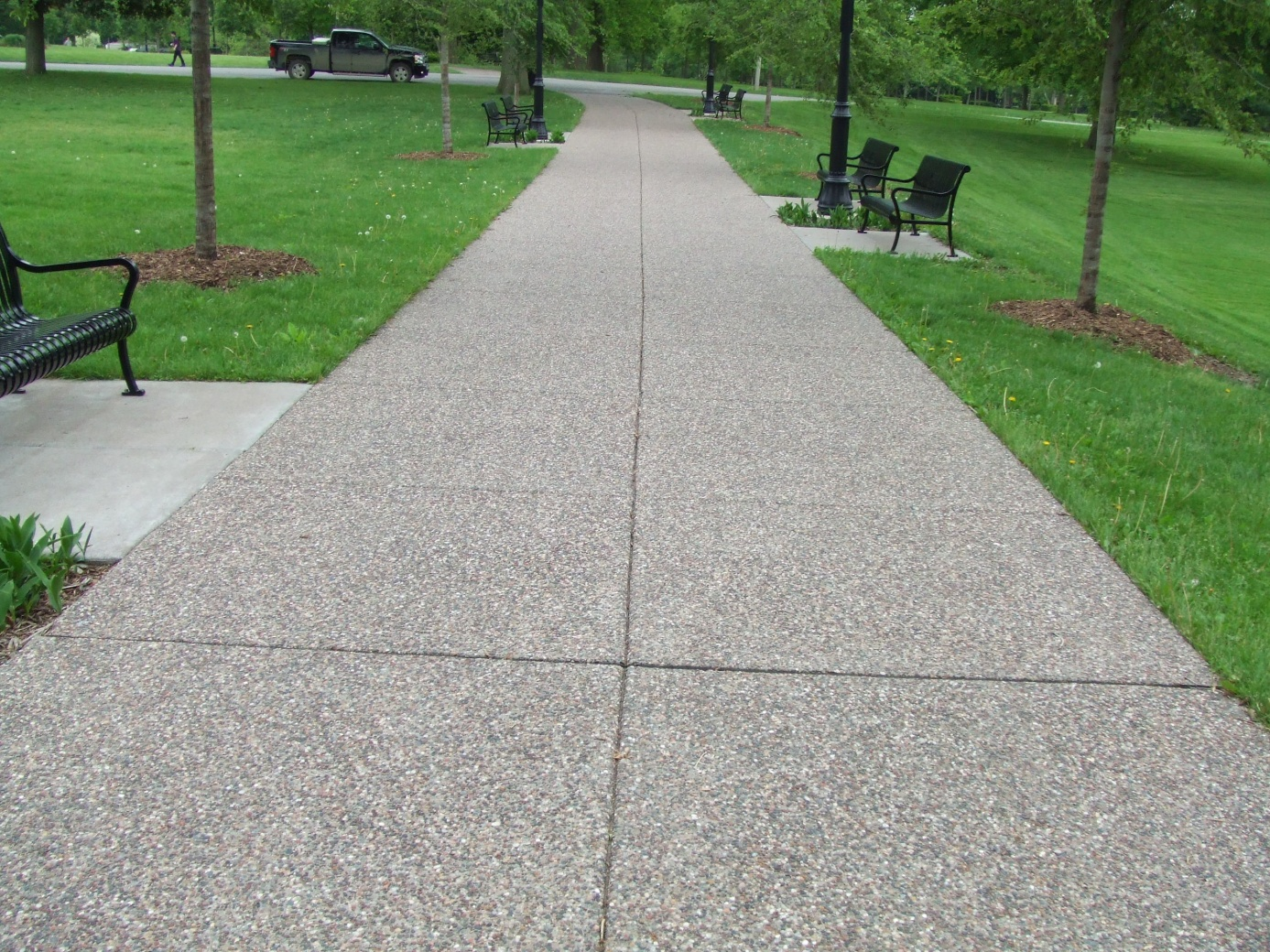 Exposed aggregate concrete walkway in Davenport park.