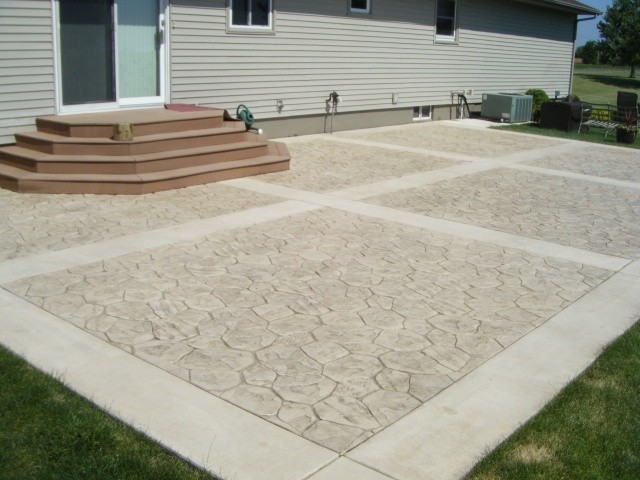 Backyard Patio Featuring Random Stone Stamped Concrete With Borders.