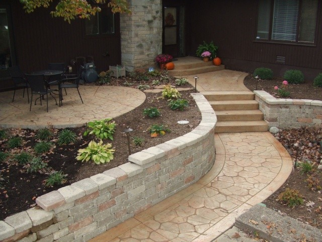 Stone stamped concrete home entryway.