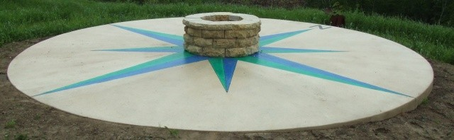 Stained concrete fire pit with compass rose.