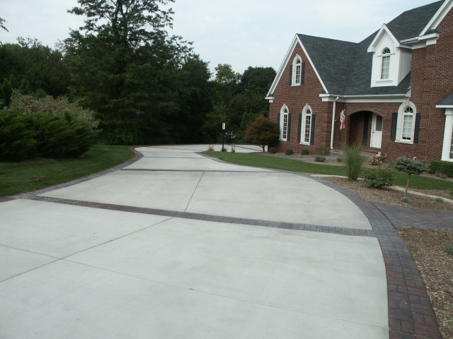 Stamped concrete regular concrete insets driveway.