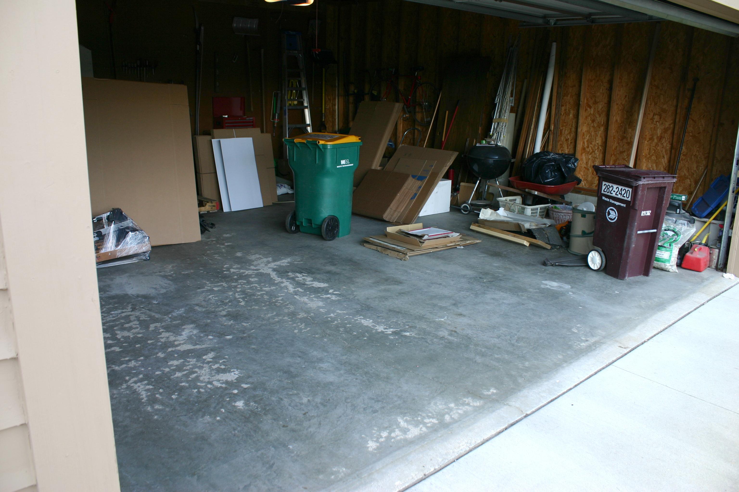 Concrete garage floor with junk in it
